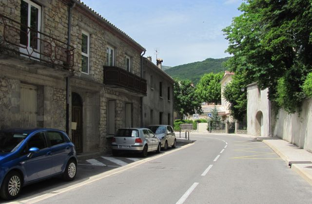 stone built houses in the green countryside on the road to millau