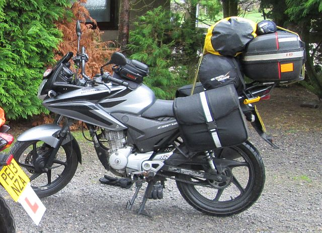 honda cbf 125 with a large camping gear load