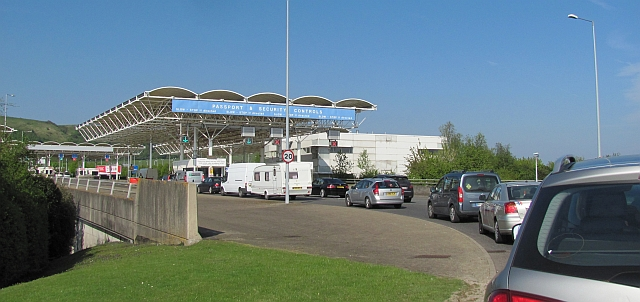 a line of vehicles waiting at passport control for the chunnel
