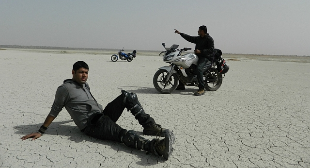 2 friends posing on their motorcycles at sambhar lake