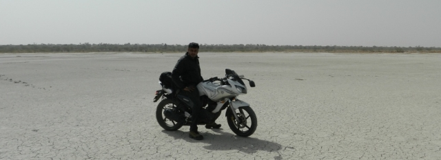 biker posing on the salt flats