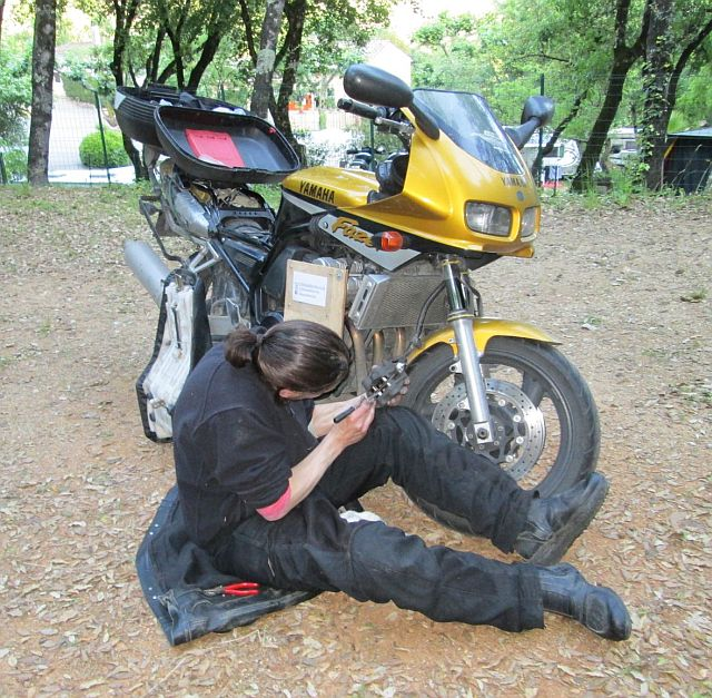 the bf sat on the floor with the front brake in bits and getting all dirty at the campsite