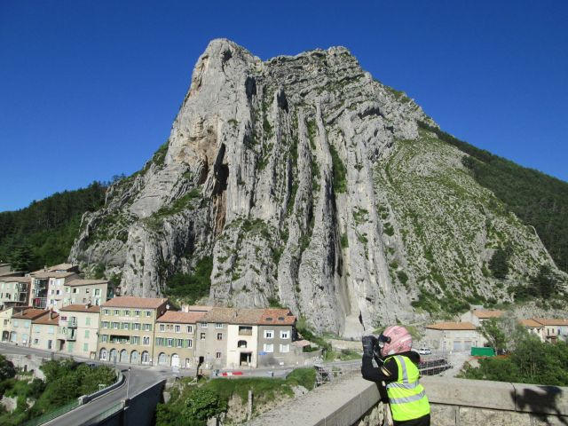 large rock formation with houses at the foot at sisteron france