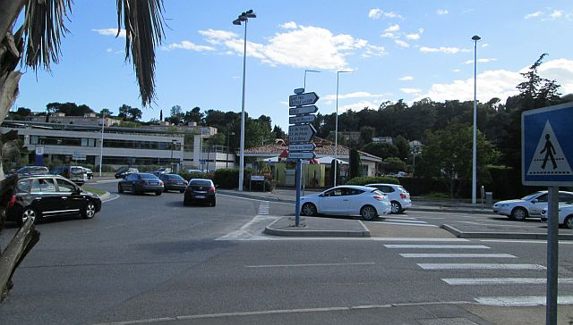 plain ordinary roundabout at la colle sur loup with traffic and buildings and faded crossings