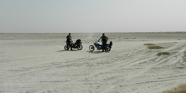 2 bikes and riders, irrelevant in the expanse of the salt lake