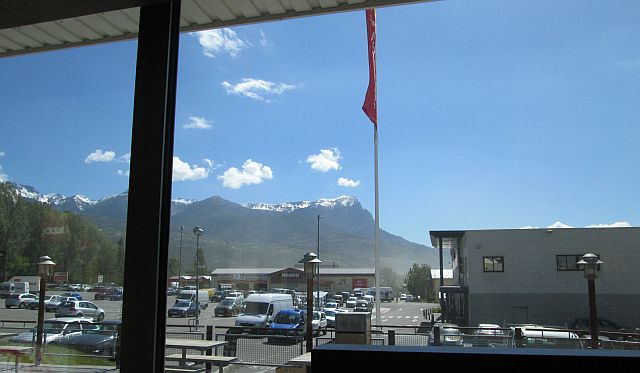 looking through the window in mcdonalds embrun to the snow capped mountains of the alps