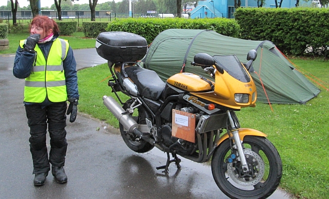 the gf standing next to the fzs600 and tent at the campsite in epernay