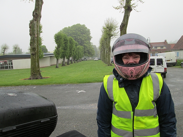th gf wearing her helmet and smiling despite the heavy rain