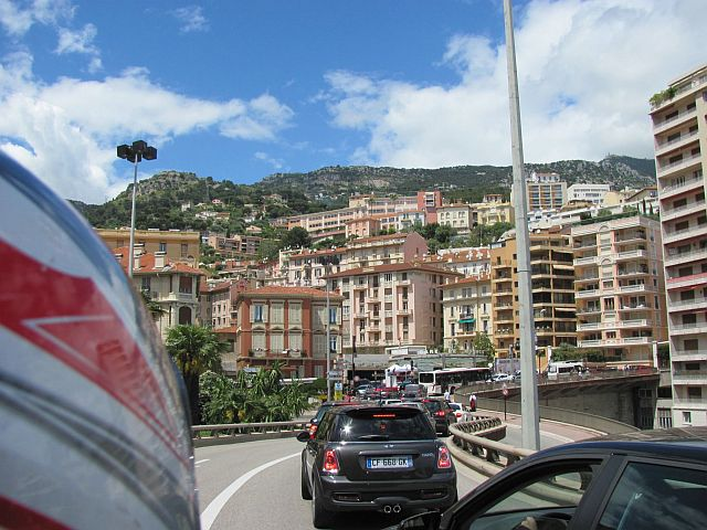tall tower blocks, apartments and buildings all squeezed into the hillside and traffic in monaco
