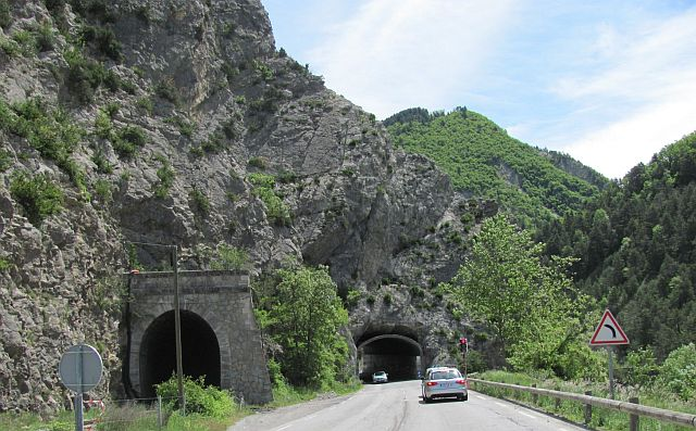 two road tunnels running through a rocky outcrop on the awesome road out of the alps towards nice