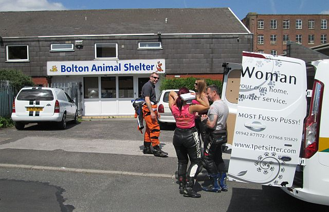 unloading the van at the bolton animal shelter and trying to cool off in the heat
