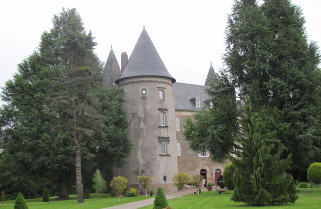 Château de Leychoisier complete with pointed spires, turrets and grounds
