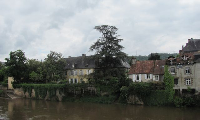 Montignac and old french houses along the swollen river