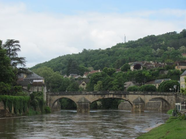 the river Vezere swollen and muddy from the torrential rains
