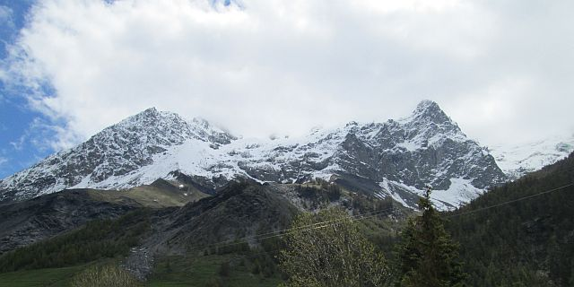 2 snow capped mountain peaks in the french alpine region