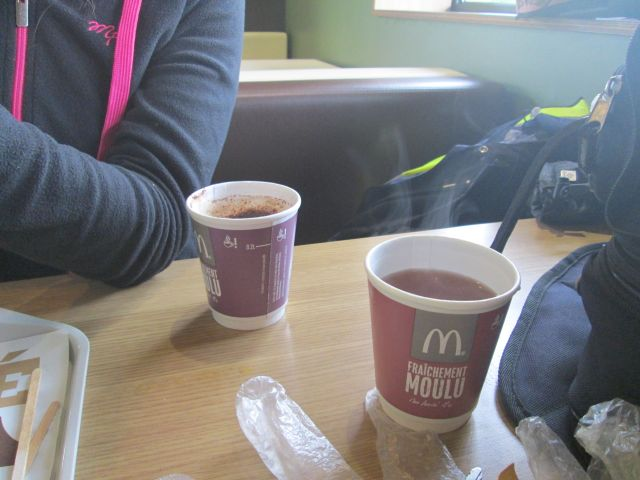 2 cups of steaming tea and coffee in a mcdonalds in cahors, france