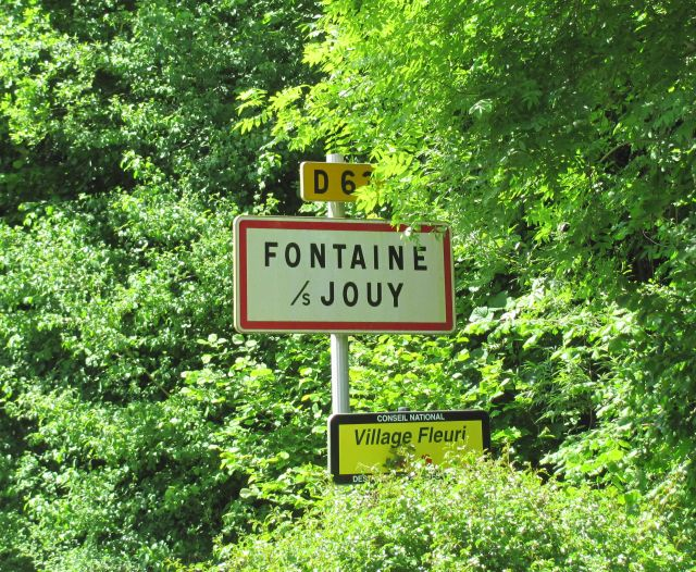 fountaine sous jouy in france town sign in the trees