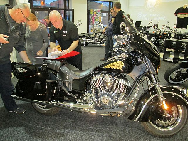 indian chieftain in balc at the showroom with potential customers