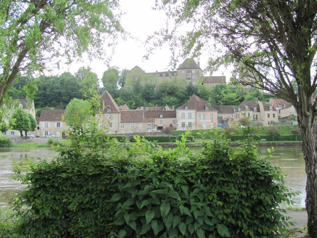 smart french houses and chateau seen from across the river at le blanc