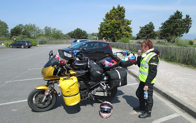 The box open on the motorcycle, the gf eating butties all on the open windswept car park of the marina