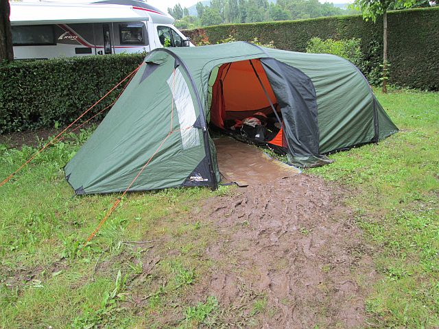 the tent with a trail of mud from the entrance to the pathway