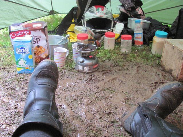 inside the porch of the tent the mud mixes with the camping gear