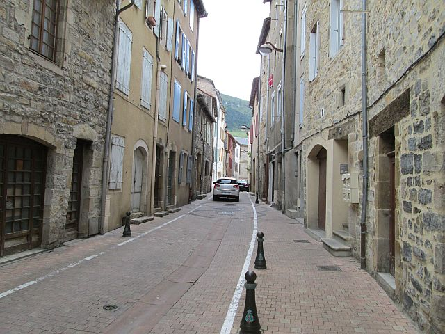 narrow street and tall french buildings in millau