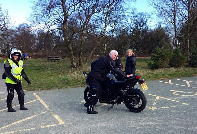 moving a motorcycle out of a disabled parking bay at sutton bank