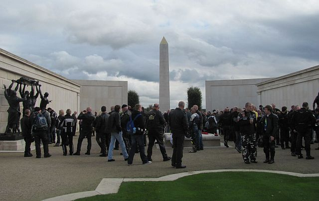 bikers looking around the large wall of remembrance