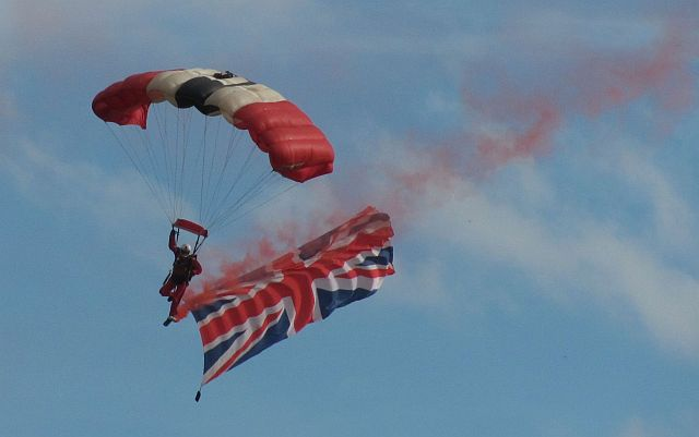 red devil sky diver with a large union jack flying beneath him