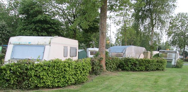 old, patched and run down caravans at the camping municipal