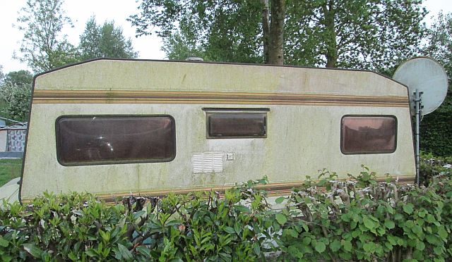 old dated caravan covered in moss for sale at friaucourt campsite