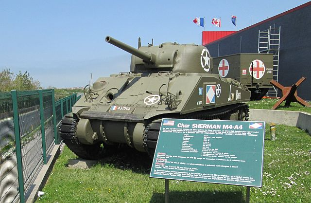 a sherman tank on display in the sun at ambleteuse ww2 museum
