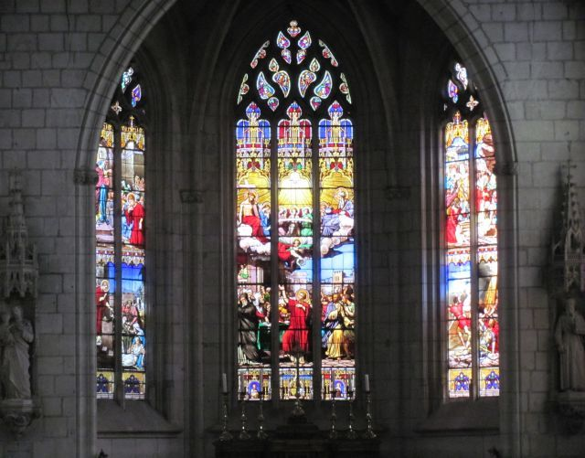 bright and colourful stained glass gothic windows of a church in chinon