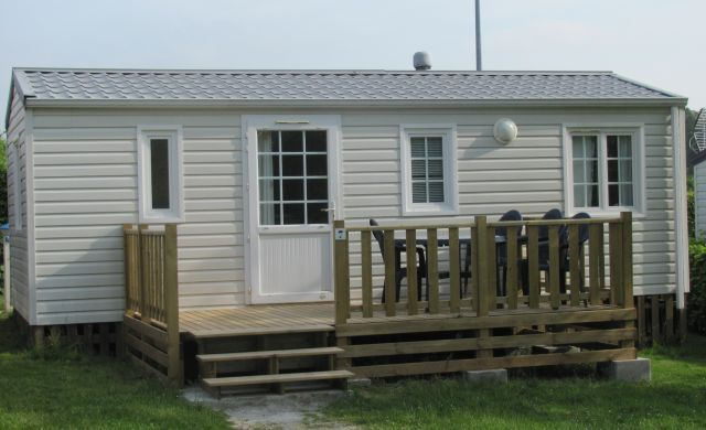 static caravan with wooden veranda