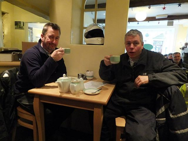 tmq and sl drinking tea at the cafe in grassington. sl is open mouthed in shock