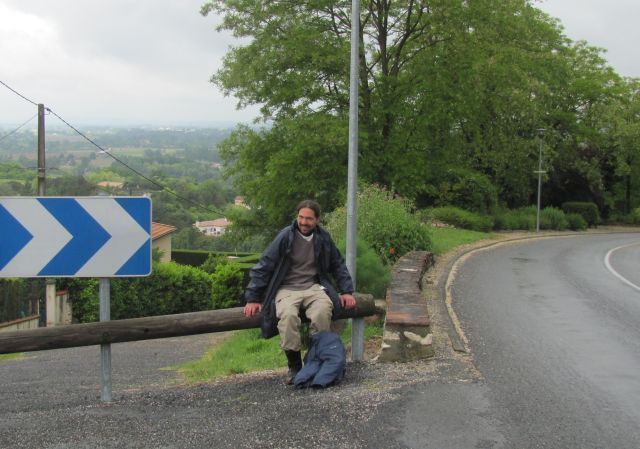 the bf as he catches his breath sat on a barrier at the top of the steep road