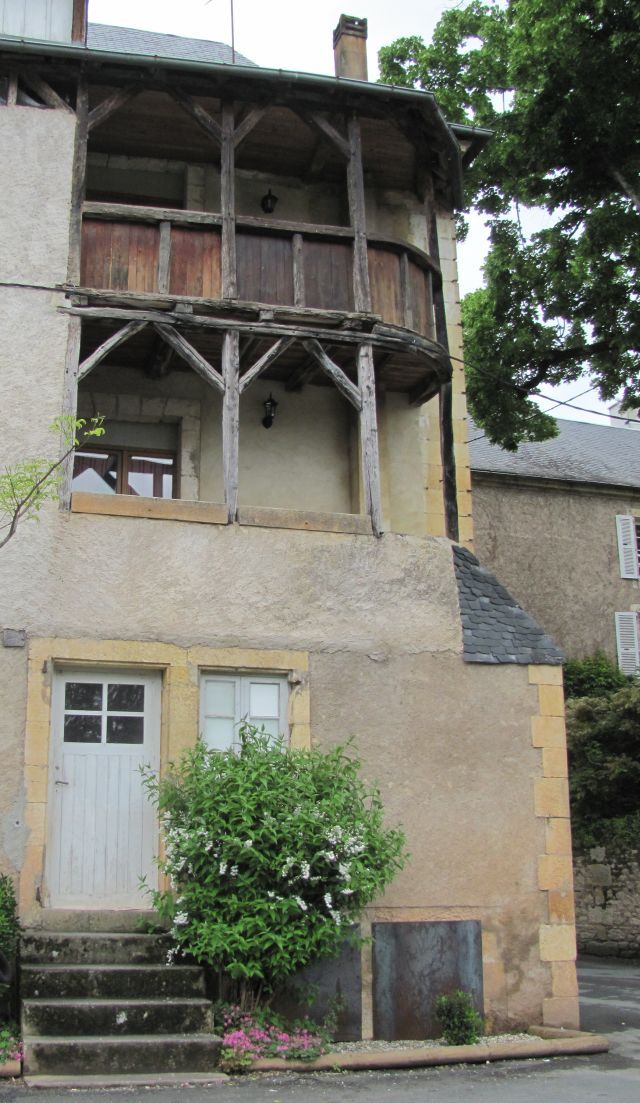 medieval timber framed balconies in a house in montignac