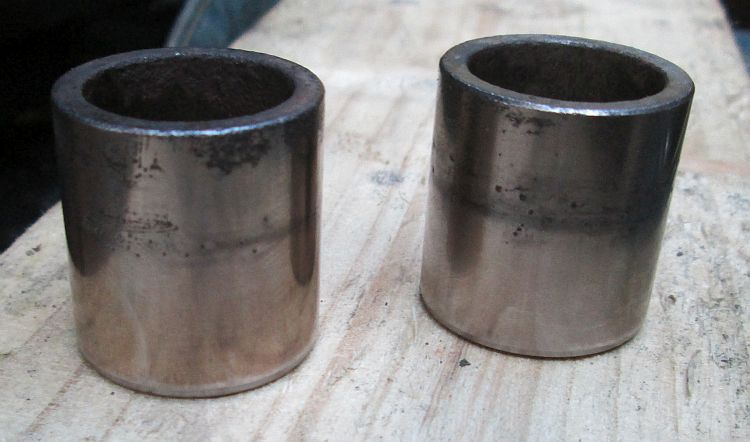 the brake pistons after being cleaned with the wire brush drill bit
