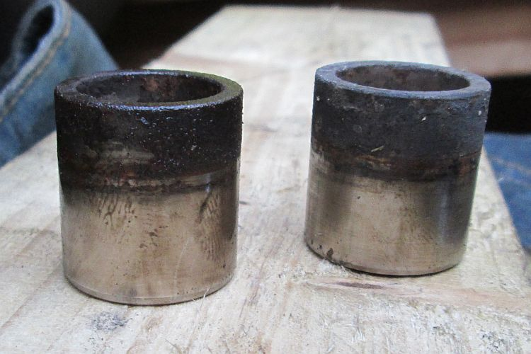 the dirty pistons after being removed from the calliper body
