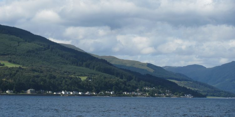 hills roll down to the shoreline as we cross the waters to dunoon