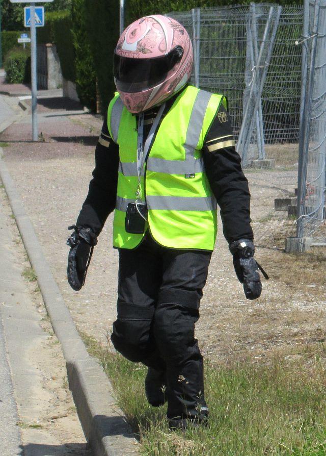 sharon in full cordura motorcycle safety gear, helmet and hi-viz vest
