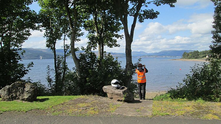 the gf in her bike gear takes a picture of the broad and mountainous bay at inverkip