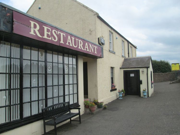 the outside of the juniperlea inn and restaurant. Just looks like a pub really