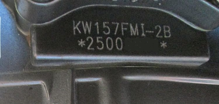 "the engine number on the keeway showing the ""KW157FMI"" engine type"