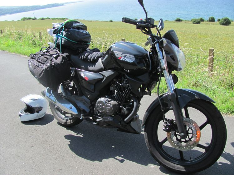 Sharon's Keeway RKS 125 at the Ayrshire coast with a big load of luggage