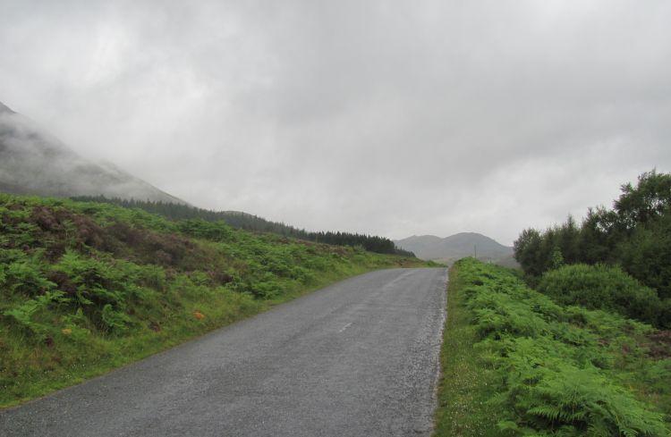 a misty empty lane lane leads across the remote Rannoch Moors