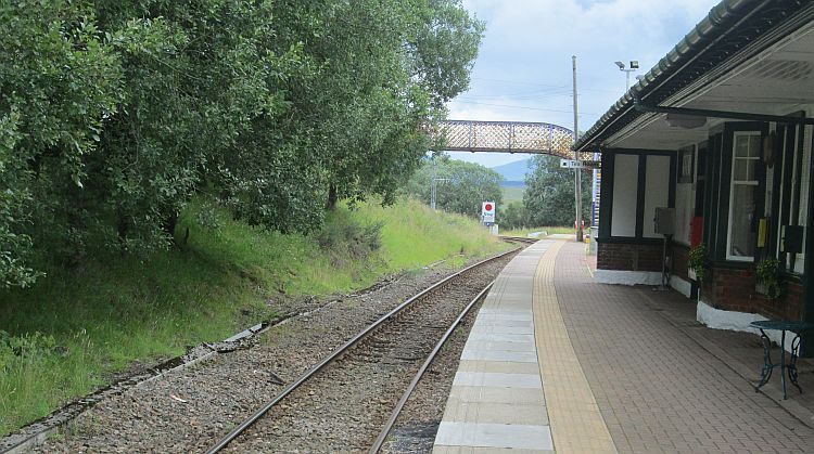 rannoch station, the walkway over the tracks, the platform and the edge of the station buildings