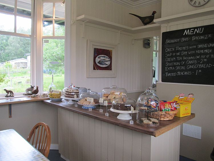 the inside of rannoch station cafe with the counter and old looks