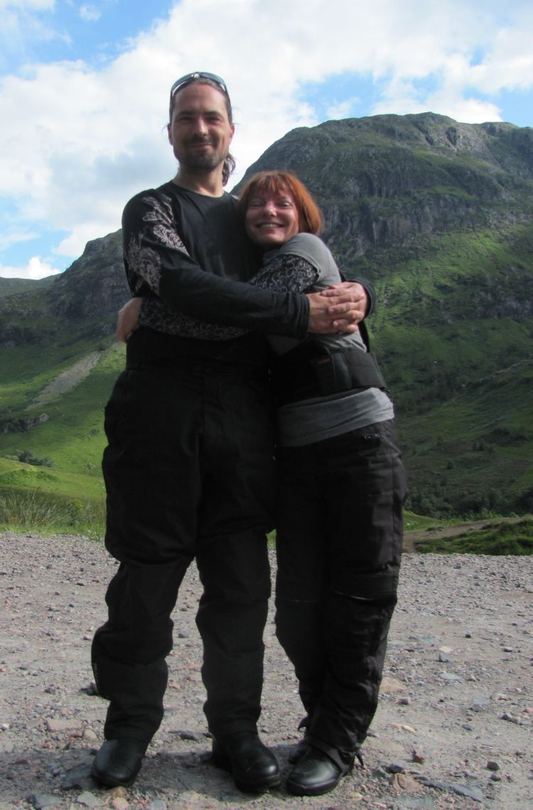 Ren and Sharon hug with clear skies and Glencoe mountains as a background